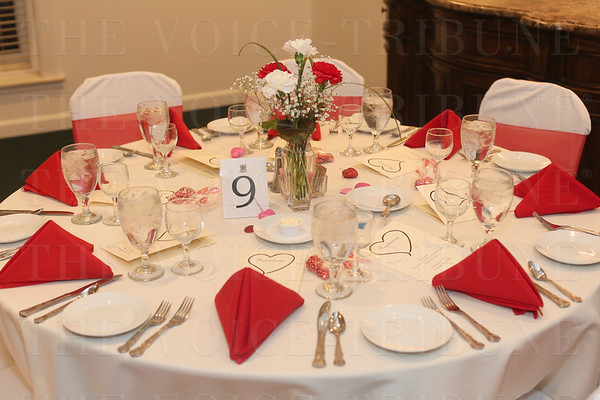 The dining tables were set and trimmed in red and white.