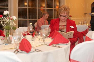 Brenda Elkins read through the event program.