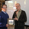 Jonathan Noffke of Solid Light receives an award for the design of the museum in Soldier's Retreat from Nick Morris.