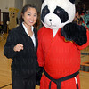 "Mimi Hwang with ""Pow the Panda"" of Hwang's Martial Arts."