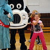 Cailin Anderson dances with the mascots.