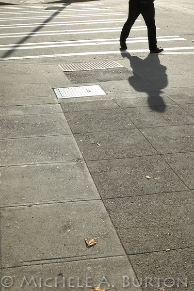 Waiting to cross; SHadows on a sunny Fall day