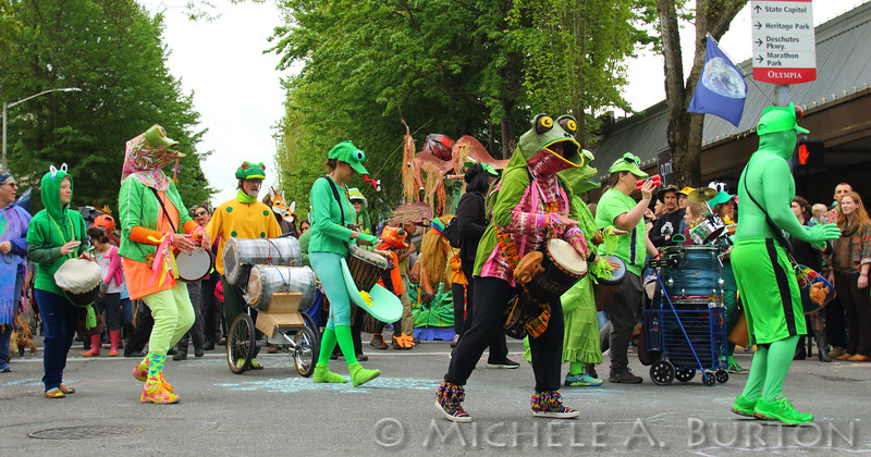 Olympia Rhythm and Dance members lend a percussive beat to the Element Earth at the 2016 Procession of the Species in downtown Olympia<br /> <br /> April 23, 2016