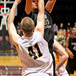 #22 Nathan Dieudonne, jumped for a short jumper as #41 Brock Kiesler, attempted to block the shot.
