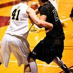#41 Brock Kiesler and #22 Nathan Dieudonne, got tied up under the basket.