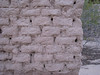 closeup of adobe wall of officer barracks of Fort Lowell