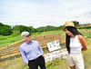 Naomi DoeMoody, co-founder of SUSU CommUNITY Farm, in Brattleboro, Vt., talks with U.S. Congressman Peter Welch (Vt-D) in front of a memorial to people who lost their lives during a visit on Friday, June 4, 2021. SUSU CommUNITY Farm is a BIPOC-led community farm that offers access to safe and affirming food.