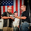 At left, Editor of The Lowell Sun Jim Campanini accepts an award from John MacDonald at the Welcome Home Concert for Veterans in Lowell. SUN/Caley McGuane