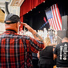 A Veteran salutes the American flag while Taps is being played before the Welcome Home Concert for Veterans. SUN/Caley McGuane