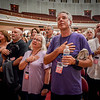 Guests place their hands over their hearts during The National Anthem at the Welcome Home Concert for Veterans in Lowell. SUN/Caley McGuane