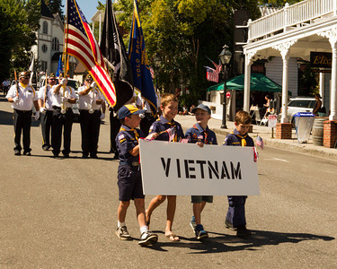"Cub Scouts with ""Vietnam War"" banner"
