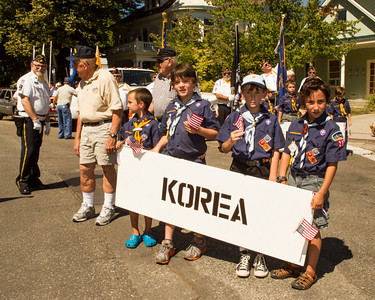 "Cub Scounts with ""Korea"" banner assembling"