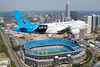 US Airways Airbus A319-112 N717UW (msn 1069) (Carolina Panthers logojet over Bank of America Stadium in Charlotte) (Jay Selman/Graham Hitchen). Image: 400600.