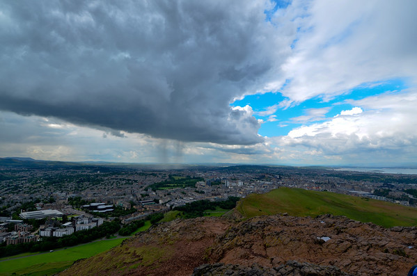 Rain in the background seen from top of Arthur's Seat, formed by ab extinct volcano, Edinburgh Scotland