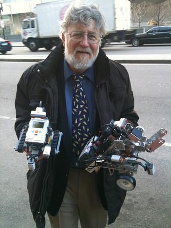 Steve with robots he built