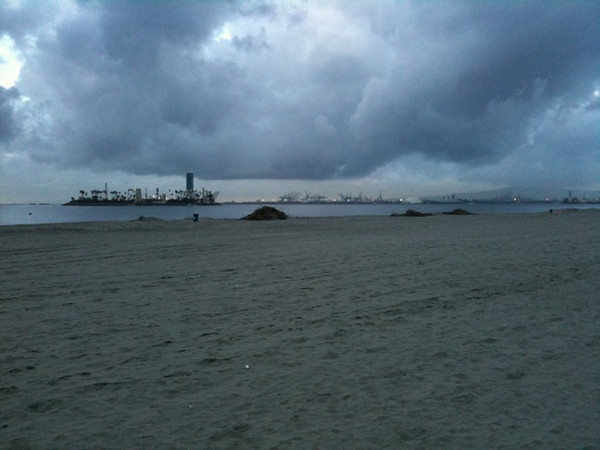 I went for a run on the Longbeach CA beach in the am.  I am told the island here is an artificial island and a spot where drilling takes place.  In this picture I like the clouds and beach make up most of it.  This is taken from my iphone.
