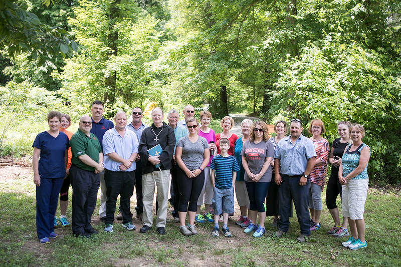 On Thursday, June 7, 2018, Archabbot Kurt Stasiak, OSB, blessed the one-mile nature trail on Saint Meinrad's campus. Darren Sroufe gave a brief overview about the trail and Ann Rohleder thanked everyone who made the trail possible. After the blessing, attendees hiked the trail that goes past both Marian Shrines, the stations of the cross and around the lakes.