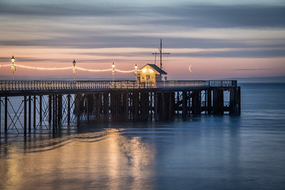 Crescent moon over Penarth pier