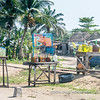 Informal motorcycle petrol stations along the road, Djeregbe, Benin