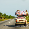 An overloaded old Peugeot 504 on its way to Ouidah, Benin
