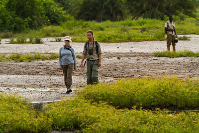Susan and guide Alon in a walk about in the Lango Bai from the Odzala Wilderness lango camp,  Odzala-Kokoua National Park, Mboko concession, Republic of Congo