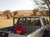 Alassane in the back of Xavier's truck.