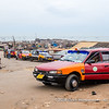 Taxis waiting at the exit of the fishing harbour of Jamestown, Accra, Ghana