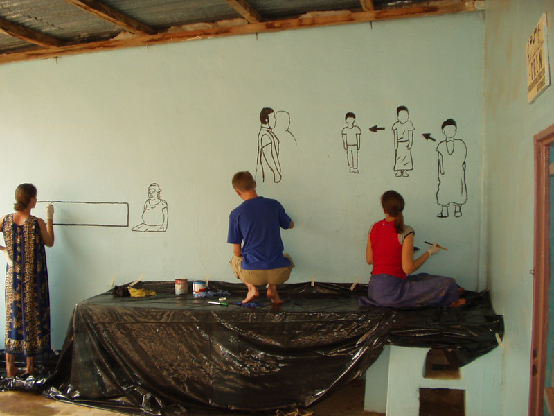 Nina, Gregor, and Molly beginning the murals.