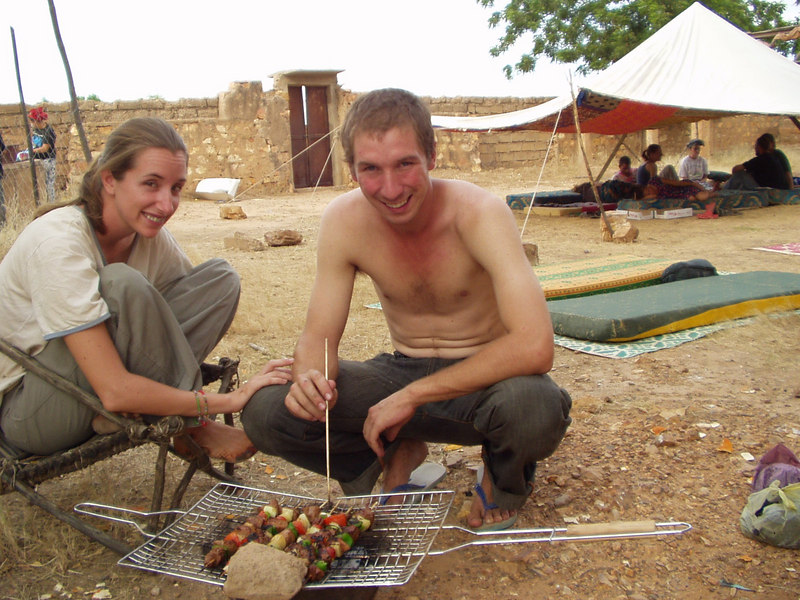 Maddy and Brock cooking shish kebabs.  Other volunteers lounging under the haima we set up in Luke's yard.