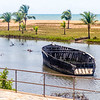 An abandoned fishing boat rotting away in the lagoon of Aného, Togo