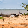 A fisherman working on his boat, Lac Togo, Togoville, Togo