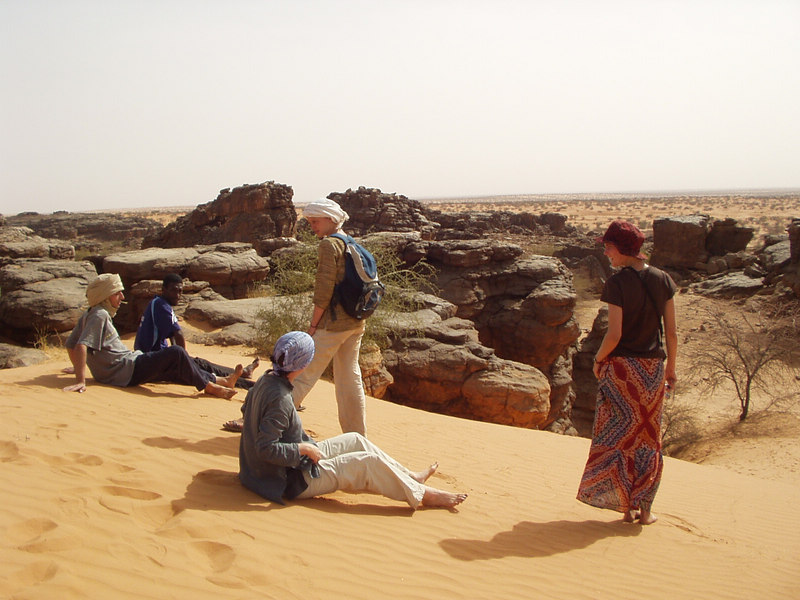 Sitting on a dune looking at the rocks--Xavier, Uda, Sylvie, Barbara, and Vinciane