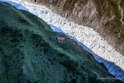 Alpine hut above the glacier