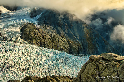 Franz Josef Glacier- Bit of an optical illusion. The glacier looks like its right there,  its actually a LONG way below the level of the edge I'm standing on