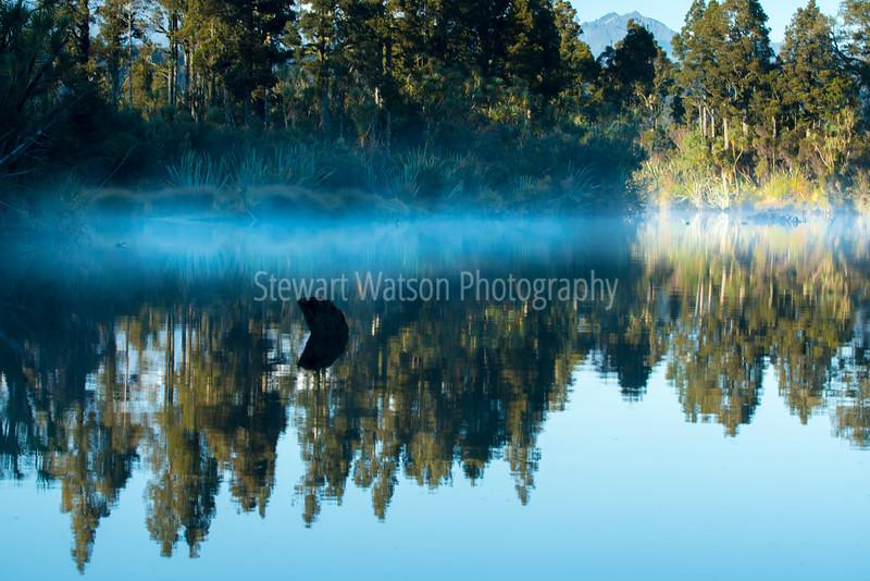 Mist and reflection on Okarito lagoon