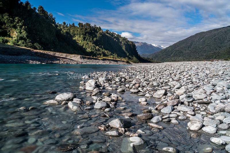 Whataroa River heading to the Alps