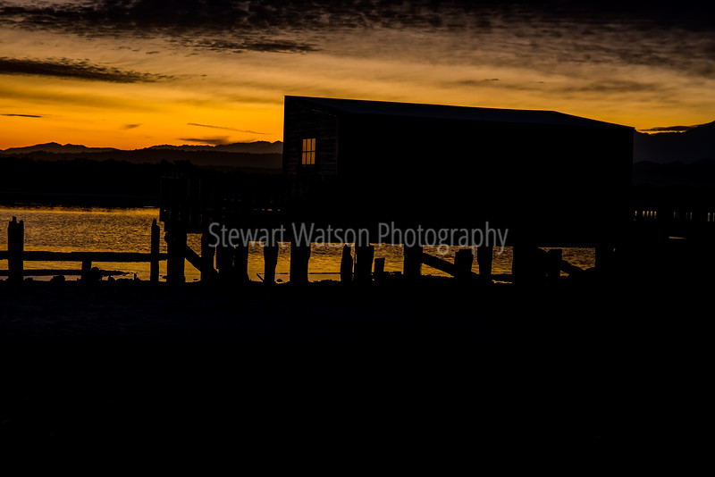 Okarito Lagoon's boatshed at sunrise