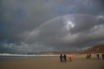 Watching the rainbow at Sennen beach