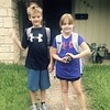 I received this picture today.  Our twin grand babies, Mitch and Astrid were off to the first day of second grade!