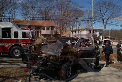 West Islip F.D. MVA w/ Car Into a House and Entrapment 889 Udall Rd. 3/13/11