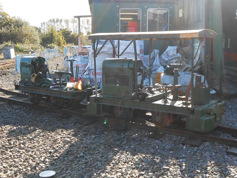 """The two Listers outside the shed in the sun <br /> <br /> Left one with no roof: <br /> <br /> R.A. Lister Ltd R type (petrol/Diesel Loco # 41 <br /> <br /> wrks no 29890<br /> <br /> year built: 1946 <br /> <br /> Right with Roof <br /> <br /> R.A. Lister Ltd Petrol Type RT Loco # 19 <br /> <br /> Wrks No 10805<br /> <br /> Year Built 1939 <br /> <br /> This is a rare survivor,<br /> <br />  being the only known Lister to have survived still <br /> <br /> fitted with it's original J.A..P Twin Cylinder """"V"""" Twin  petrol engine"""