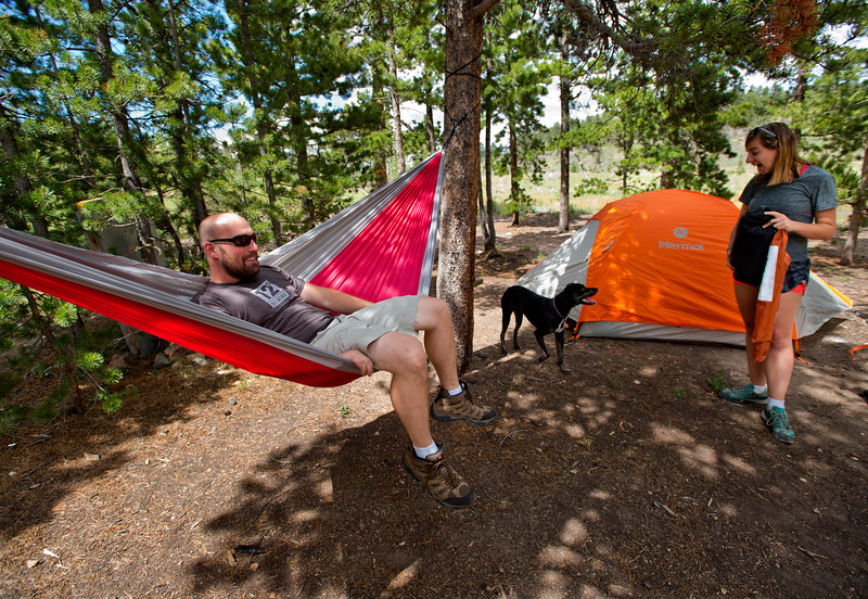 "Conrad Andrews sits in a hammock after he and his girlfriend Ashley Aldhizer set up their tent in the West Magnolia Campground, south of Nederland, on Friday afternoon. <br /> For more photos go to  <a href=""http://www.dailycamera.com"">http://www.dailycamera.com</a><br /> (Autumn Parry/Staff Photographer)<br /> June 24, 2016"