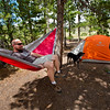 """Conrad Andrews sits in a hammock after he and his girlfriend Ashley Aldhizer set up their tent in the West Magnolia Campground, south of Nederland, on Friday afternoon. <br /> For more photos go to  <a href=""""http://www.dailycamera.com"""">http://www.dailycamera.com</a><br /> (Autumn Parry/Staff Photographer)<br /> June 24, 2016"""