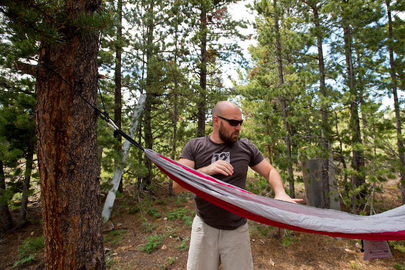 "Conrad Andrews hangs a hammock as he and his girlfriend Ashley Aldhizer settle into their campsite at West Magnolia Campground, south of Nederland, on Friday afternoon. <br /> For more photos go to  <a href=""http://www.dailycamera.com"">http://www.dailycamera.com</a><br /> (Autumn Parry/Staff Photographer)<br /> June 24, 2016"
