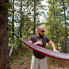 """Conrad Andrews hangs a hammock as he and his girlfriend Ashley Aldhizer settle into their campsite at West Magnolia Campground, south of Nederland, on Friday afternoon. <br /> For more photos go to  <a href=""""http://www.dailycamera.com"""">http://www.dailycamera.com</a><br /> (Autumn Parry/Staff Photographer)<br /> June 24, 2016"""