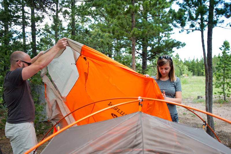 "Conrad Andrews and his girlfriend Ashley Aldhizer set up their tent at West Magnolia Campground, south of Nederland, on Friday afternoon. <br /> For more photos go to  <a href=""http://www.dailycamera.com"">http://www.dailycamera.com</a><br /> (Autumn Parry/Staff Photographer)<br /> June 24, 2016"