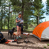 """Ashley Aldhizer unpacks food as she and her boyfriend Conrad Andrews settle into their campsite at West Magnolia Campground, south of Nederland, on Friday afternoon. <br /> For more photos go to  <a href=""""http://www.dailycamera.com"""">http://www.dailycamera.com</a><br /> (Autumn Parry/Staff Photographer)<br /> June 24, 2016"""