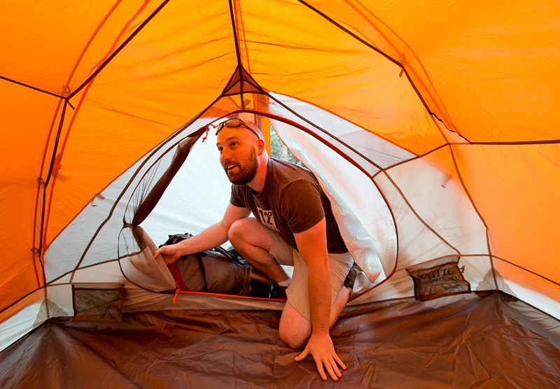 "Conrad Andrews puts up a tent for the weekend as he and his girlfriend Ashley Aldhizer settle into their campsite at West Magnolia Campground, south of Nederland, on Friday afternoon. <br /> For more photos go to  <a href=""http://www.dailycamera.com"">http://www.dailycamera.com</a><br /> (Autumn Parry/Staff Photographer)<br /> June 24, 2016"