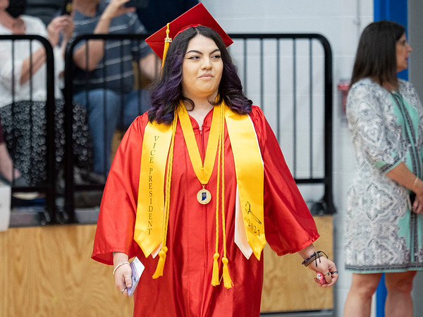 West Noble class of 2021 vice president Angela Caldwell enters the gym during Friday's  West Noble High School Class of 2021 Commencement at West Noble High School in Ligonier.