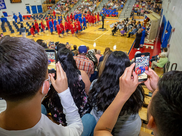 West Noble graduate family members use their smart phones to photograph the opening ceremony during Friday's  West Noble High School Class of 2021 Commencement at West Noble High School in Ligonier.